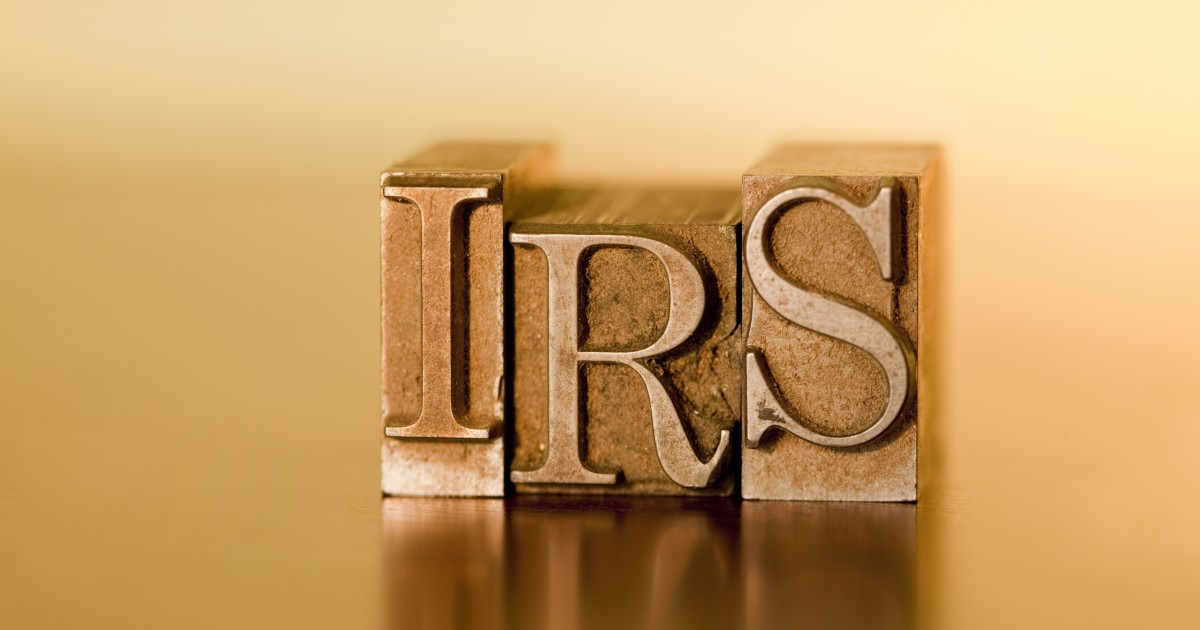 IRS stamp letters on gold background