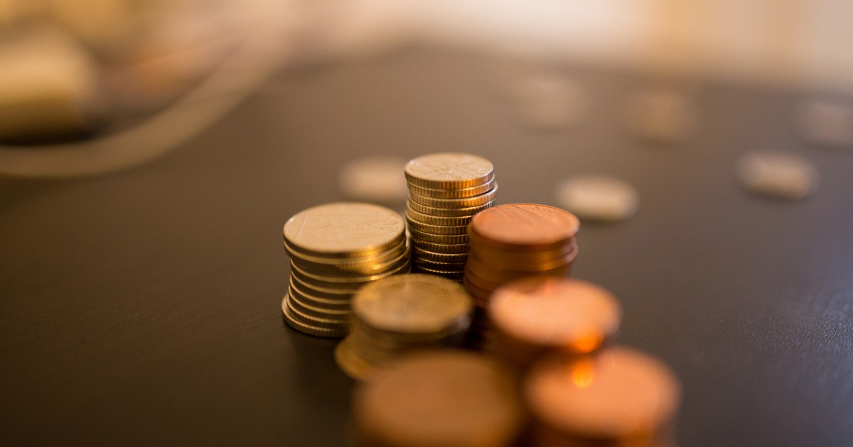 Stack of coins on desk with blur effect