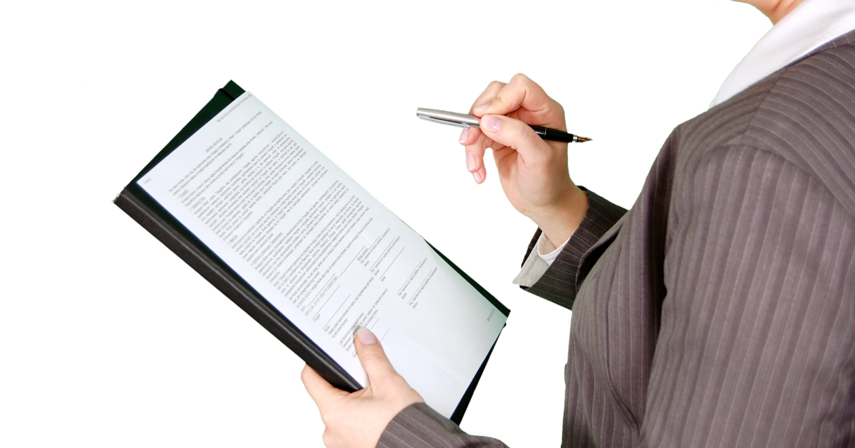Person preparing to sign a form