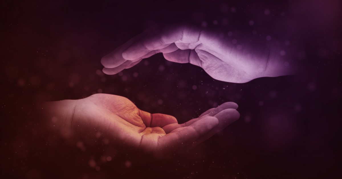 Two cupped hands gently reaching toward one another